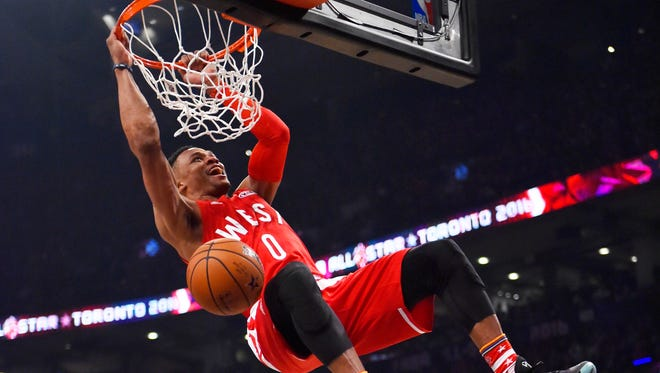 Western Conference guard Russell Westbrook of the Oklahoma City Thunder (0) dunks in the first half of the NBA All Star Game at Air Canada Centre.