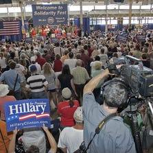 Sen. Hillary Clinton, center on the stage,  addressed the large crowd gathered for the Labor Day Fest held in the 4-H Exhibits Building at the Iowa State Fairgrounds in Des Moines on Sept. 3, 2007