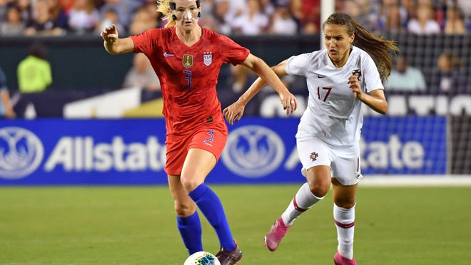 Aug 29, 2019; Philadelphia, PA, USA; United States midfielder Sam Mewis (3) pushes the ball past Portugal forward Vanessa Marques (17) during second half of U.S. Women's National Team Victory Tour soccer match at First Financial Field. Mandatory Credit: Eric Hartline-USA TODAY Sports