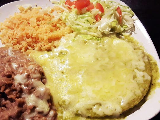 The green enchilada plate ($7.20) with a side of refried