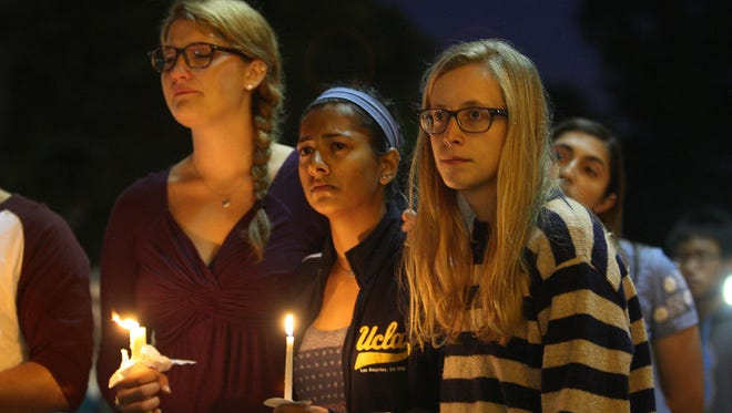 Students from the University of California- Santa Barbara and the University of California-Los Angeles attend a candlelight vigil May 26 in Los Angeles for the victims of a killing rampage.