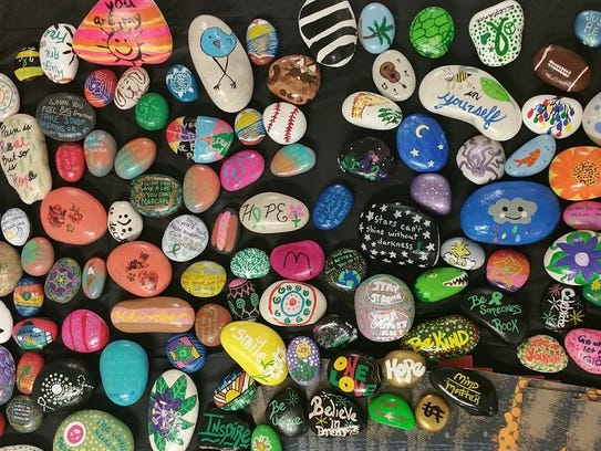 These PSL Rocks rocks were painted for a fundraiser.