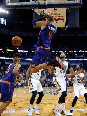 Suns center Tyson Chandler (4) dunks over Pelicans forward Anthony Davis during the first half game in New Orleans, Friday, Nov. 4, 2016.