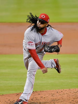 Cincinnati Reds starting pitcher Johnny Cueto (47) delivers a pitch.