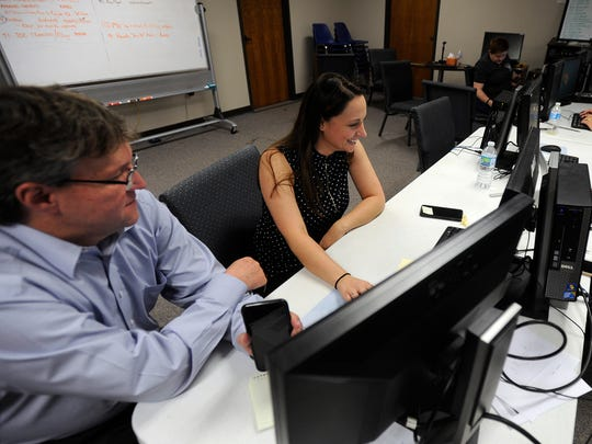 Scott Mattson, product instructor for Spillman Technologies, works with Aymee Henning, records supervisor for the Abilene Police Department,  on the police department's newly installed public safety software on Thursday, May 4, 2017, at the Abilene/Taylor County Law Enforcement Center.