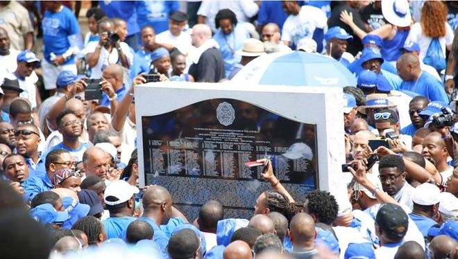 Members surround the Phi Beta Sigma Fraternity Inc. monument at Howard University in Washington, the site of the organization's first chapter, during the Centennial celebration on Jan. 9, 2014.