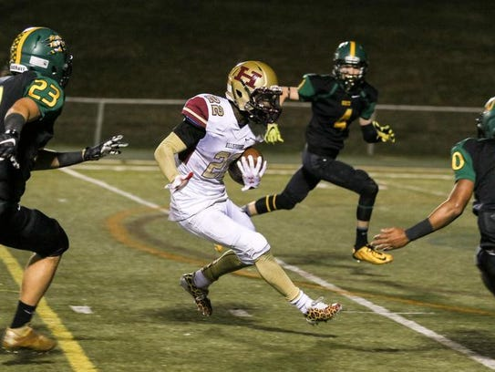 Hillsborough's Tyler Boatwright runs the ball as North
