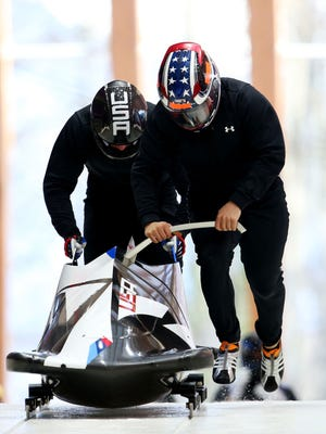 Justin Olsen pushes for pilot Cory Butner in training for two-man.