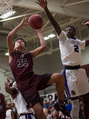 Cane Ridge's Damion Baugh (2) tries to block a shot