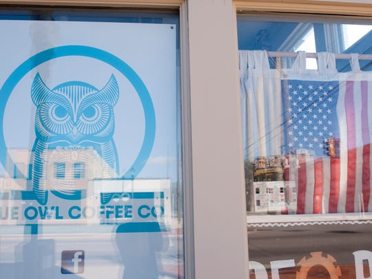 An American flag sits in the window of the future Blue Owl Coffee Co. in REO Town on Friday, Sept. 2, 2016.