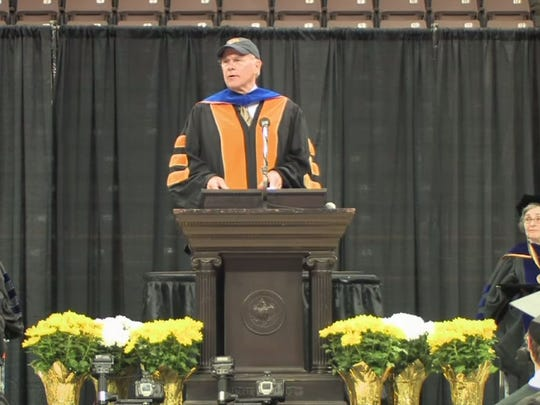 This image is a screenshot from a video recording of Tom Brokaw, the former anchor of NBC News, addressing graduating University of Iowa students in 2010.