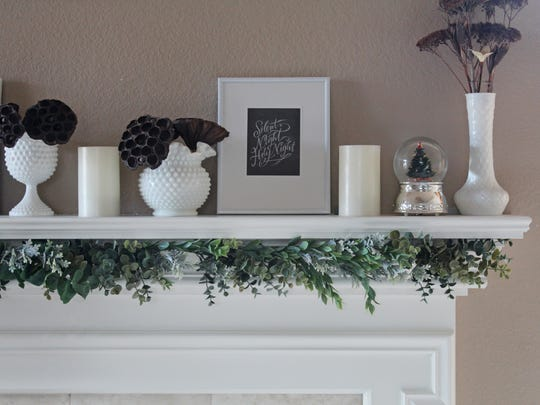 A handmade eucalyptus garland ushers in the season with subtlety. Hang it under your mantel for a fresh look.