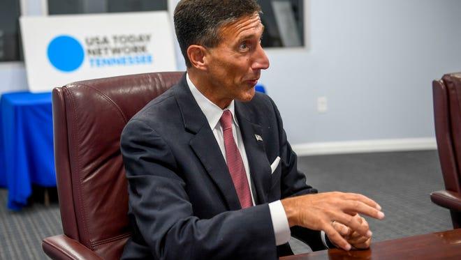 U.S. Representative David Kustoff (R - TN, 8th District) speaks to reporters at The Jackson Sun in Jackson, Tenn., on Thursday, Aug. 16, 2018.