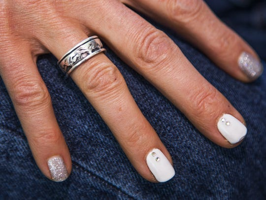 Amanda Marsh still wears her husband's wedding ring.