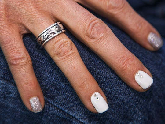 Amanda Marsh still wears her husband's wedding ring.