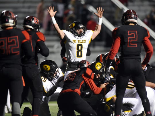Caleb Craig signals for a touchdown on Andrew Newsom's short run during Tri-Valley's 36-30 overtime win against BelleFontaine on Friday in a Division III regional semifinal game at Westerville Central.