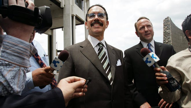 May 31, 2005 - Former State Senator John Ford  smiles as he speaks to the media before entering the Federal Building in downtown Memphis.