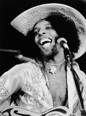 """Singer Sylvester """"Sly"""" Stone performs with the music group Sly and the Family Stone in 1972."""