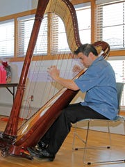 """Harpist Ted Davenport of Apalachin performs """"Wind Beneath"""