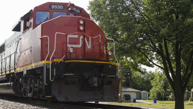 A Canadian National engine idles on the railroad tracks beside East Randall Avenue in Appleton in 2016.