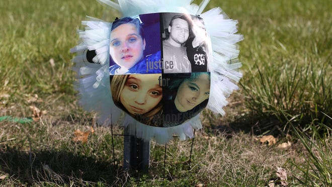 A small memorial at the intersection of Ohio 32 and Union Hill Rd in Pike County some of the eight victims killed Friday in what's being called execution style murders. Ages of the victim are 16-44. Top left, Chris Rhoden, 16, Frankie Rhoden and his fianc Hannah Gilley, Bottom left, Hanna Rhoden, 19 and her mom, Dana Rhoden.