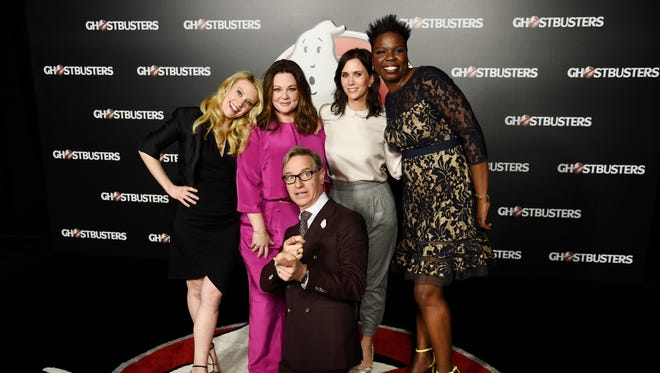 "Paul Feig, center, writer-director of the upcoming film ""Ghostbusters,"" poses with cast members, Kate McKinnon, from left, Melissa McCarthy, Kristen Wiig and Leslie Jones backstage during the Sony Pictures Entertainment presentation at CinemaCon 2016."