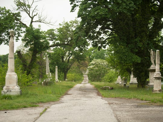 The Evergreen Cemetery in Camden is overgrown and littered with trash and debris.