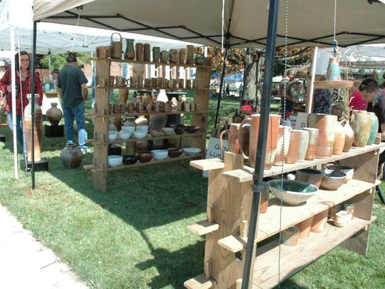 Shoppers browse pottery booths at a past Potterypalooza.