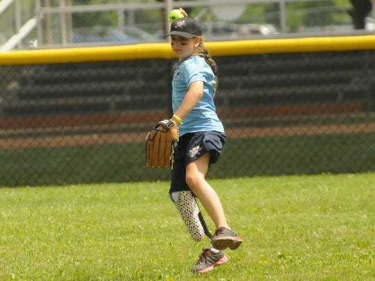 Annie Flood of Salem throws  during the Wounded Warriors Amputee Softball Camp in Louisville, Ky .
