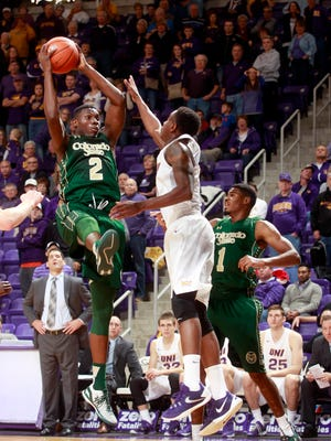 Northern Iowa's Aarias Austin, center, goes up against Colorado State's Emmanuel Omogbo, left, for a rebound as Antwan Scott, right, defends during the second half of an NCAA college basketball game at the McLeod Center Saturday in Cedar Falls, Iowa.