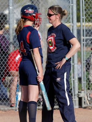 Appleton East softball coach Janel Batten (right) is leaving the school to become athletic director at Pulaski High School.