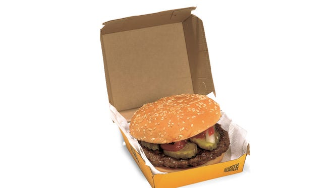 This is the McDonald's Quarter Pounder, 410 calories, 19g fat, 7g saturated and 730mg sodium from the book Eat This, Not That by David Zinczenko with Matt Goulding.