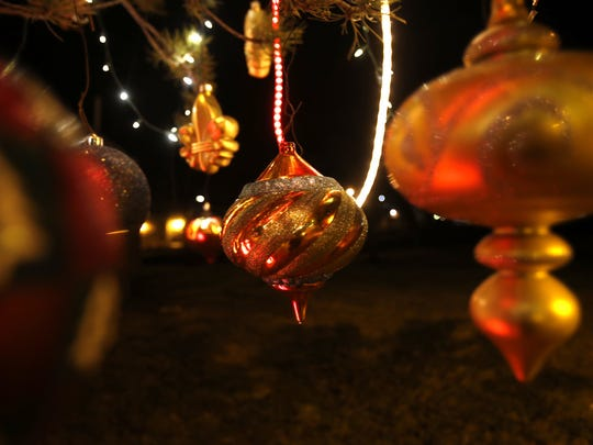 Ornaments hang on a tree at Minium Park in Aztec. The City of Aztec kicks off its annual Aztec Sparkles Lighting Contest on Dec. 1.