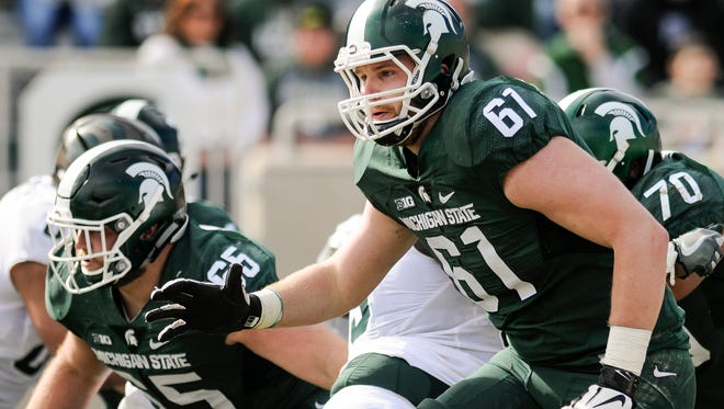 MSU left tackle Cole Chewins (61) and center Brian Allen (65) figure to be two staples of MSU's offensive line this season.