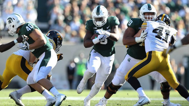 Michigan State's LJ Scott runs the ball against Iowa during the second quarter of MSU's 17-10 win over Iowa on Saturday, Sept. 30, 2017, in East Lansing.