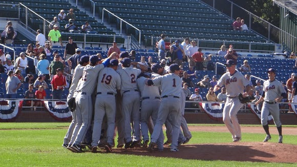 The Binghamton Mets swarm the mound after defeating the Portland Sea Dogs on Sunday.