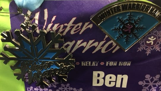 My Winter Warrior Half Marathon finisher's medal, left,