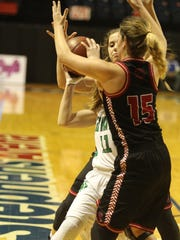 Garden City High School's Payton Hastings (15) applies
