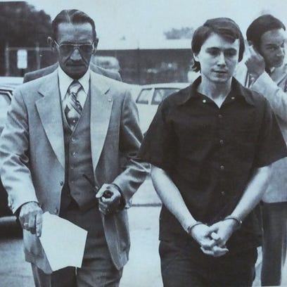 Don Miller, shown in a 1979 photo, is escorted into