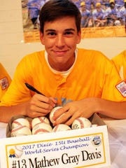 Matthew Davis took time out from lunch on Wednesday to sign autographs on balls. Alvin Benn/Special to the Advertiser. 7-26-17