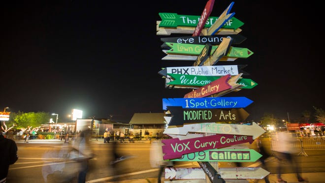 A sign at 4th and Roosevelt Streets shows people where attractions are located during First Fridays down Roosevelt Row, February 6th, 2015, in Phoenix, Ariz.