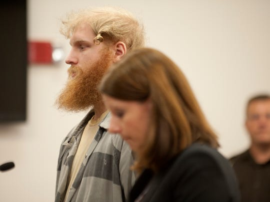 """Grant Taylor's attorney, right, filed a motion seeking a change of venue, saying it will be """"impossible"""" to find a fair and impartial jury in Ingham County. Taylor is charged with murder in the death of Lansing firefighter Dennis Rodeman."""