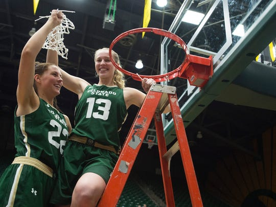 Ellen Nystrom and Elin Gustavsson cut the net from the basketball hoop after a 64-51 win over Nevada and Mountain West Championship on at Moby Arena Friday, March 3, 2017.