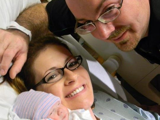 Jennifer E. Jenkins, 35, posed with her newborn daughter, Ashley, and husband Daniel R. Jenkins, 33, all of Naples, in this October photo. Jennifer Jenkins was killed in a crash early Dec. 30, 2011, in Hardee County. Also killed was her longtime friend, Kathleen M. O'Callaghan, 34, of Naples, who was a passenger in Jennifer Jenkins' car. (Photo via Facebook)