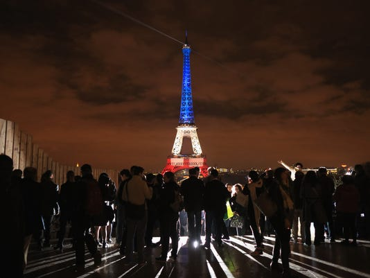 BESTPIX Paris Turns Blue, White and Red For Victims Of Friday's Terrorist Attacks