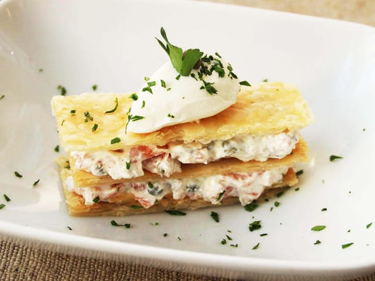A puff pastry Napoleon is filled with smoked salmon and sour cream.
