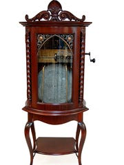This Regina Model 35 upright bow front automatic 12 disc changer, circa 1899-1910, realized $15,600 in J. Levine's 2014 New Year's Day auction. Courtesy photo/J. Levine Auction & Appraisal.