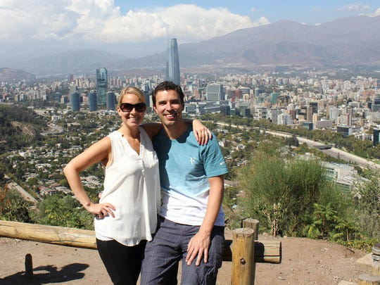 Husband and wife entrepreneurs, Julie and Jim Welsh have their own company, Amaze Travel. They are at San Cristobal Hill with downtown Santiago, Chile in the background. It's an agency that, in the age of name-your-price online travel agencies, caters to people seeking luxury -- and personal -- experiences.