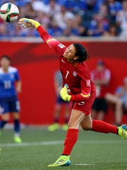 United States goalkeeper Hope Solo (1) throws the ball
