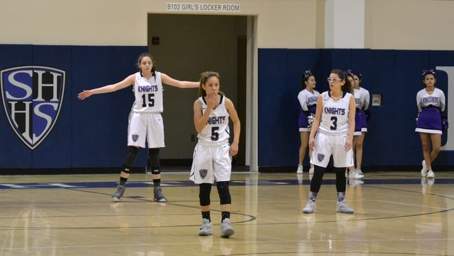 Sisters Valerie (15) and Mireya (3) Phlaum were both born deaf and are members of the Shadow Hills varsity girls' basketball team